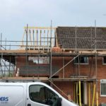 house extension being built in background with Create Builders branded van parked in foreground