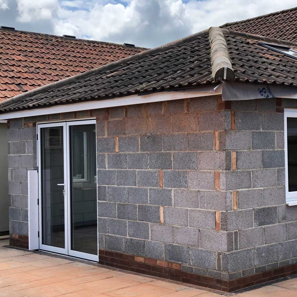 garage extension with double glass doors